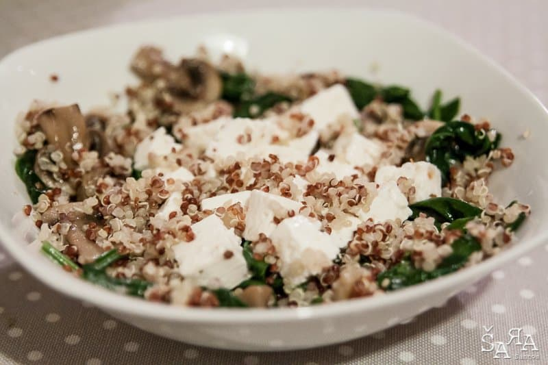 Quinoa salad with fresh cheese, spinach and mushrooms